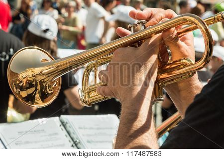 Man Playing Brass Lacquered Trumpet