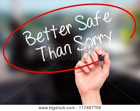 Man Hand Writing Better Safe Than Sorry With Black Marker On Visual Screen