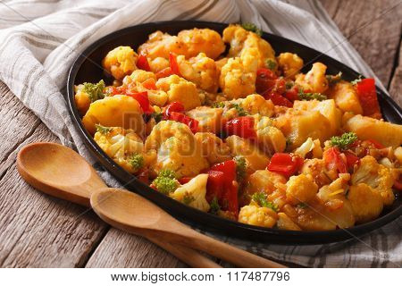 Indian Vegetarian Gobi Aloo Close-up On A Plate. Horizontal