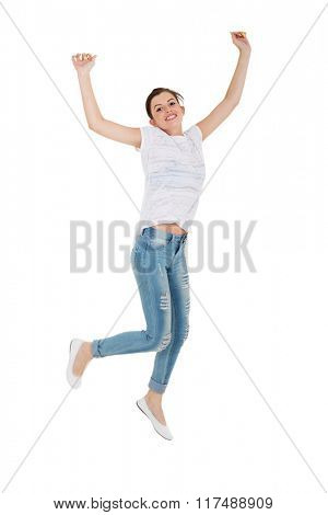 excited teen girl jumping isolated on white