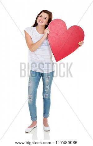 pretty teen girl holding heart shape over white background
