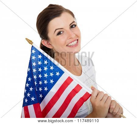 portrait of pretty teen girl holding USA flag