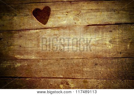 Valentine's day concept background . Love text on wooden background