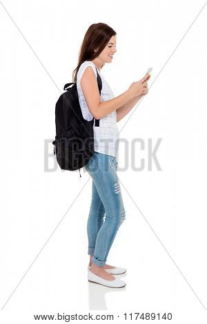 side view of pretty university student texting on smart phone