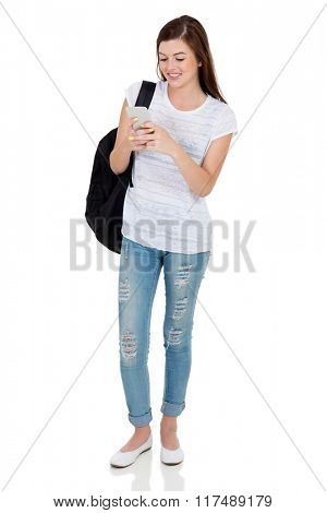 happy female university student using cell phone isolated on white