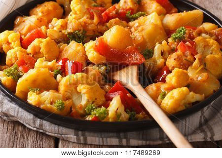 Indian Cuisine: Gobi Aloo Close-up On A Plate. Horizontal