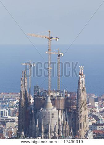 Sagrada Familia In The Background Of The Sea