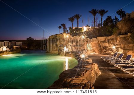 Long exposure shot of swimming pool at luxury night illumination