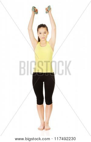 Active woman holding weights.