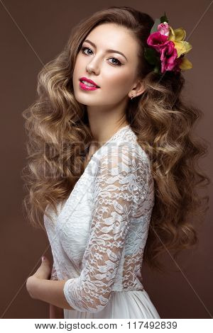 Beautiful blond woman in wedding dress with evening make-up, tender lips and curls. Bride image. Bea