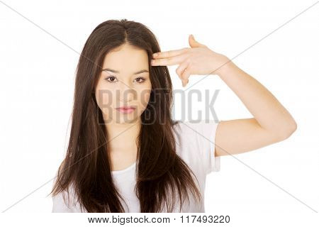 Young woman showing suicide sign.