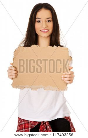 Young woman holding a cardboard.
