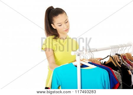 Beautiful woman thinking what to dress.