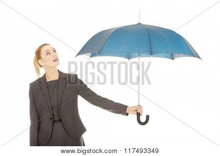 Businesswoman holding an umbrella.