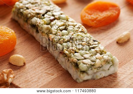 Granola Bar With Dried Frouits And Nuts On Wooden Board