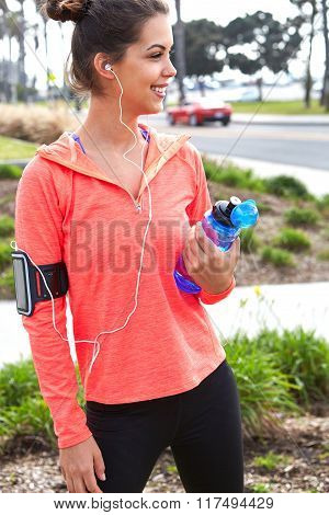 Beautiful fitness athlete woman drinking water