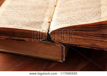 Open Old Book With Frayed Pages Close-up