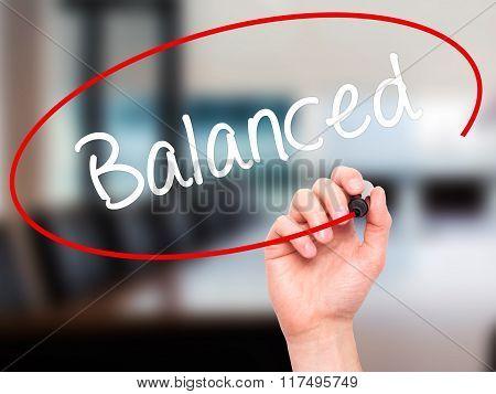 Man Hand Writing Balanced With Black Marker On Visual Screen