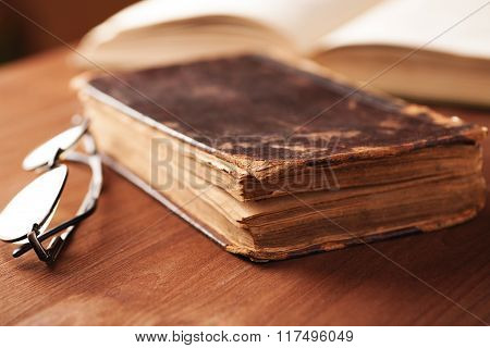 Old Book In A Leather Cover On Wooden Table