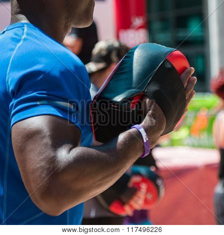 Man At Gym Doing Fitness With Punching Mitts