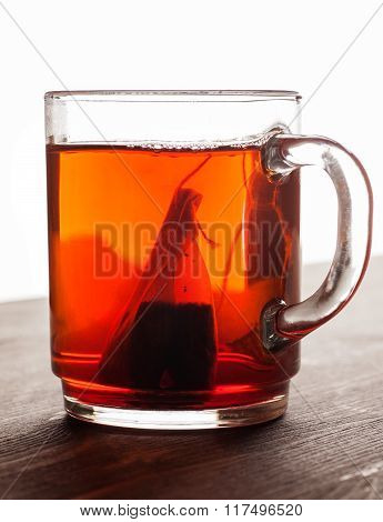 Tea Bag In Glass Mug On Wooden Table