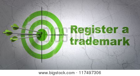 Law concept: target and Register A Trademark on wall background