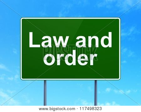 Law concept: Law And Order on road sign background