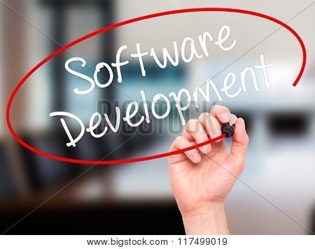 Man Hand Writing Software Development With Black Marker On Visual Screen