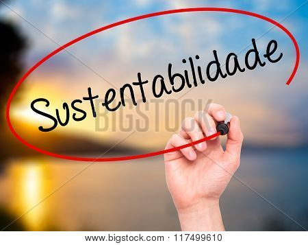 Man Hand Writing Sustentabilidade (in Portuguese - Sustainability) With Black Marker On Visual Scree