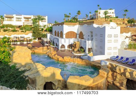 Panorama of white city at tropical luxury resort hotel, Egypt