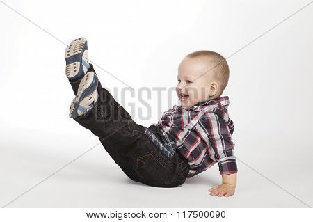 little boy with legs up