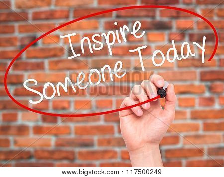 Man Hand Writing Inspire Someone Today With Black Marker On Visual Screen