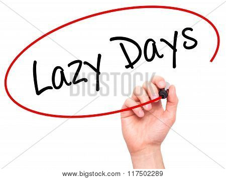 Man Hand Writing Lazy Days With Black Marker On Visual Screen.
