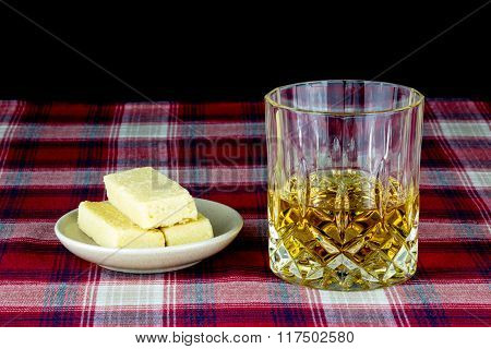 Scotch Whisky And Shortbread On A Tartan Table Cloth