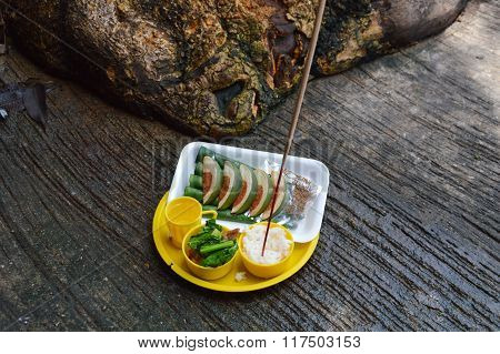 food in plastic tray for sacrifice to the wandering spirit