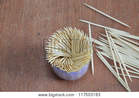 toothpick in box packaging on wooden board
