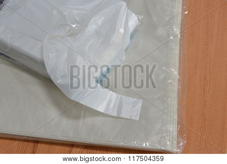 white plastic bag packing on table