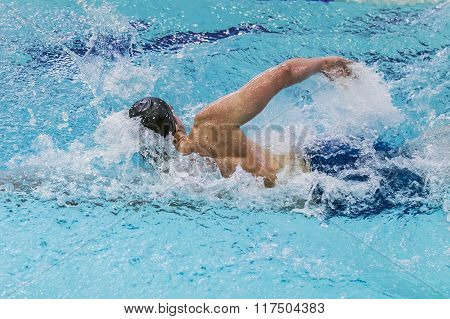 young athlete swims freestyle