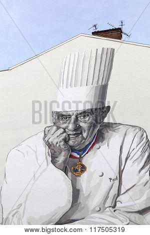 Facade in Lyon with Paul Bocuse portrait
