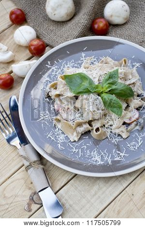 Pasta With Cheese, Mushrooms, Cherry Tomatoes And Basil. At The Plate Is Burlap, Mushrooms And Tomat