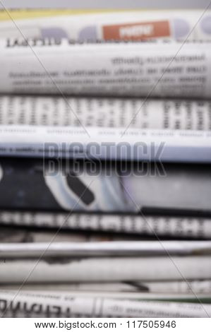 specially defocused stack of newspapers blurred background