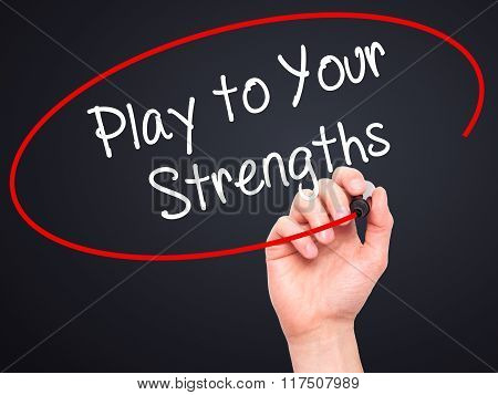Man Hand Writing Play To Your Strengths With Black Marker On Visual Screen.