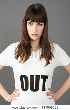 Young Woman Supporter Wearing T Shirt Printed With Out Slogan