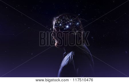 Profile of a bearded man head with  symbol neurons in brain. Thinking like stars, the cosmos inside