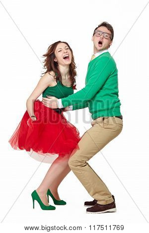 Excited young couple dancing