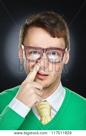 Weird young man wearing eyeglasses
