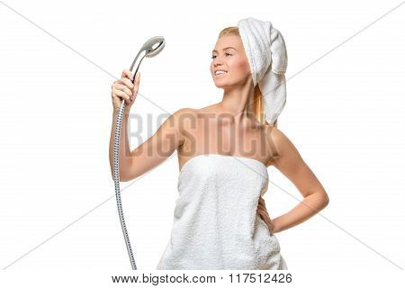 Woman in towel singing using shower head