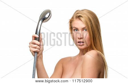 Young woman in a towel holding shower head