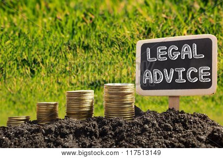 Legal Advice - Financial opportunity concept. Golden coins in soil Chalkboard on blurred urban backg