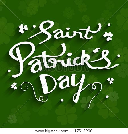 Stylish text Saint Patrick's Day on clover leaves decorated green background.